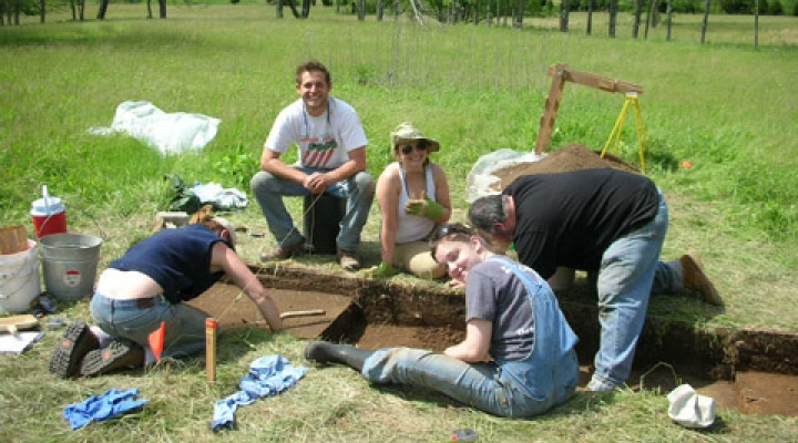 Archaeology students working at a site