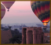 Hot air balloons flying over Luxor at twilight